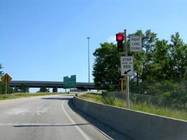 Ramp meters, as shown here, are a cost-effective way to manage the flow of traffic and do not require the construction of new lanes.